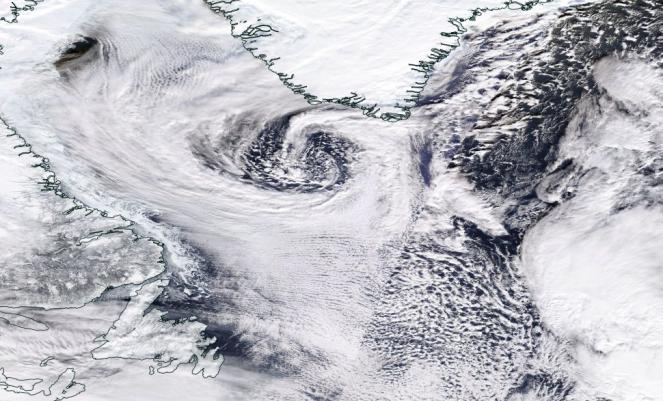 Ciara in formazione, in uno scatto satellitare nel visibile tra le coste canadesi e la Groenlandia